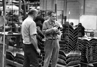 Charles Eames (right) visiting the Herman Miller factory, where the Eames Lounge and Ottoman has been produced since its 1956 debut.