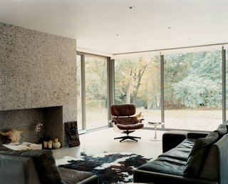 The owners of this modern home on the outskirts of London, adorned with an Eames Lounge, originally planned to use it as a weekend getaway, but after completing renovations, they couldn't imagine leaving on Sunday afternoons.