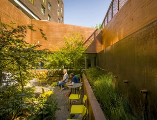 This outdoor space features hardy materials like concrete and weathering steel—along with Mayer/Reed-specified, drought-tolerant, and native plants and grasses.