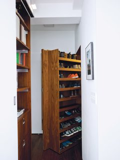 With space for shoes (the pair don't wear any in the home), Rollerblading gear, umbrellas, and more, the deep entrance closet helps the couple maintain their minimalist interior. A hanging rod, made by Specialty Lighting, has an integrated light that turns on when the 200-pound door is opened. specialtylighting.com