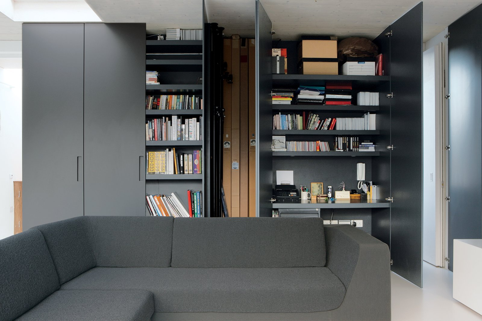 Reeve's partner, Michela Meazza, uses built-in closets for her home office. The imposing gunmetal gray doors can simply be swung shut at the end of a long day's work.  Photo 12 of 13 in All Clad