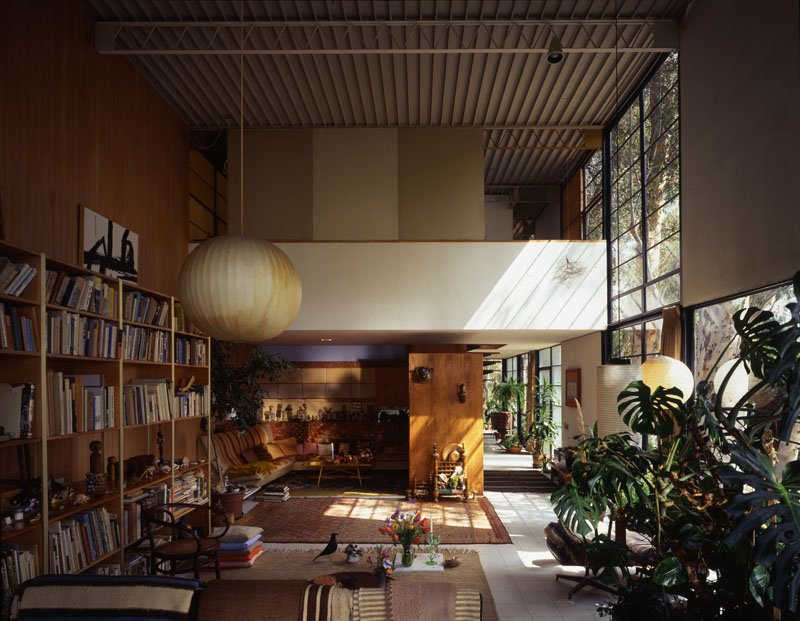 The Eames house living room as it is best known, shot in 1994. The light from the window illuminates the tumbleweed the couple picked up on their honeymoon drive from Chicago to Los Angeles; due to its fragility it was the only item not to have been moved to the LACMA exhibition. Photo courtesy Tim Street-Porter.  Photo 3 of 3 in 10 Inspiring Quotes from the Eames Family