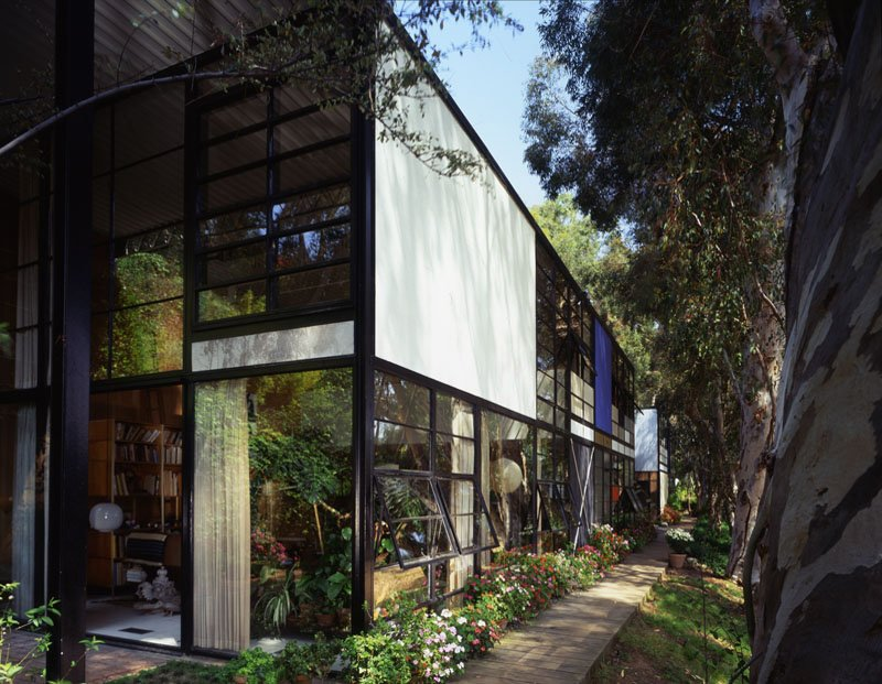 The living room in 1994 from the outside looking in, the angle from which most visitors view the space. Ray bordered the house with potted plants, which remain outside today. Photo courtesy Tim Street-Porter.  Photo 1 of 3 in 10 Inspiring Quotes from the Eames Family
