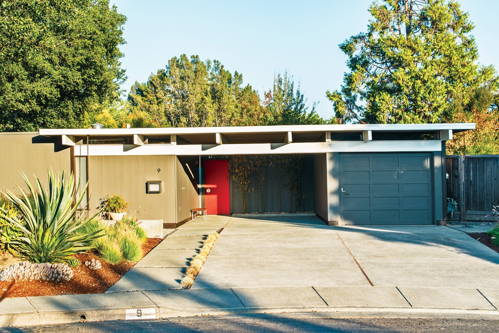 Exterior, Mid-Century Building Type, Flat RoofLine, and House Building Type The exterior of Neely and Kefalides's house is punctuated with a bright red door.  Photo 9 of 15 in Modern Furniture Fit for a Classic Eichler