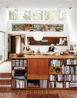 The Right Track - Photo 1 of 15 - Cohen and his wife, Sally, sit in the dining room, which along with the connected living room, is a focal point of the house, lighted in part by high, remote-controlled clerestory windows.