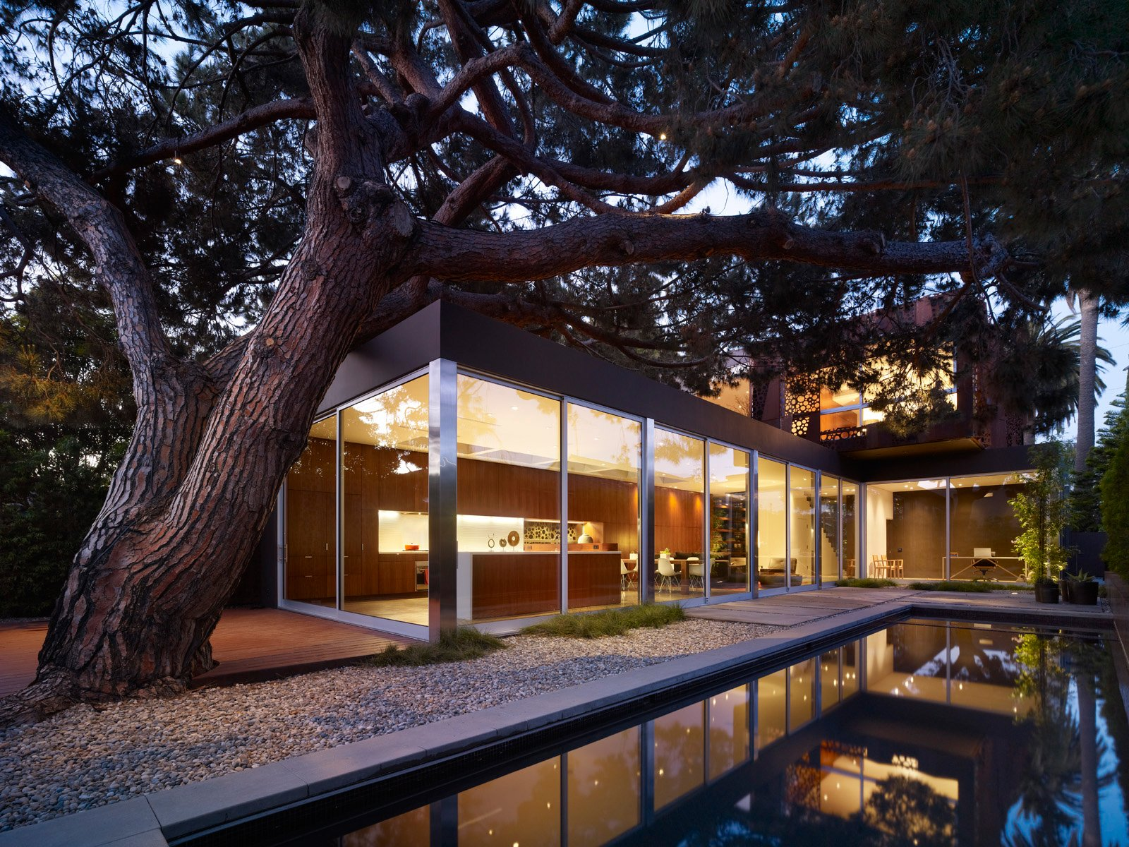 Finally, the stone pine tree reveals itself from the backyard looking over the Venice neighborhood. Its canopy stretches over the first floor of the home and can be glimpsed by the skylights placed strategically above the living area.  Ways to Incorporate Trees into Homes by Diana Budds from Top 10 Houses on Dwell This Week December 19, 2013