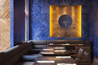 A combination of textured blue ceramic tiles inspired by Marmara marble (made by Autoban) and traditional Iznik tiles, handmade by Turkish craftsmen in Istanbul, are used in this Turkish restaurant in London.