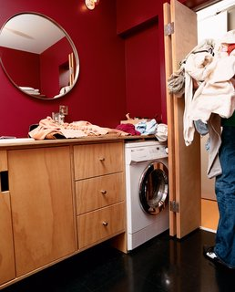 Tips for Tiny Bathrooms - Photo 6 of 12 - The house's small square footage also necessitated that the bathroom do double duty as the laundry room.