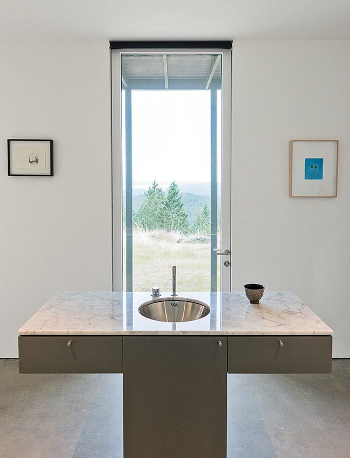 Bath Room and Marble Counter Seattle's Special Projects Division designed the custom cabinetry throughout the house. A Vola faucet is integrated with the Carrara marble vanity.  Photo 6 of 18 in Idyllic Home Designed for an Artist