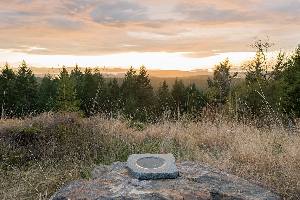 A stone bowl Brothers made in the 1990s is positioned on a rock. Tagged: Outdoor and Woodland.  Photo 15 of 18 in Idyllic Home Designed for an Artist