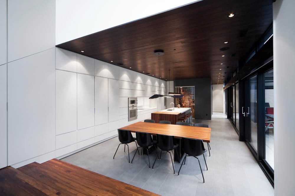 Life ceramic tiles by Ciot were used in the kitchen. The veneer cabinets were made by Bruno Pichet.  Photo 3 of 7 in Near Montreal, a House Connects With Its Surroundings