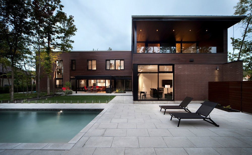 A glass barrier around the pool contributes to the project's overall sense of transparency.  Photo 7 of 7 in Near Montreal, a House Connects With Its Surroundings