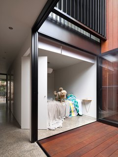 """An internal courtyard anchors the house while ushering in air and light. Its materials echo those used in the rear yard. """"You get a glimpse of both outdoor spaces when walking through the house,"""" Abicic says."""