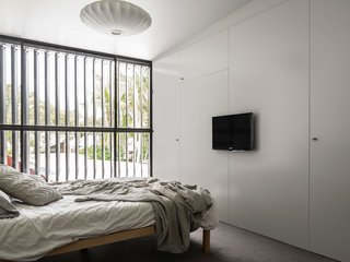 Full height louvers are used throughout the house, opening the interior spaces up to the outdoors.