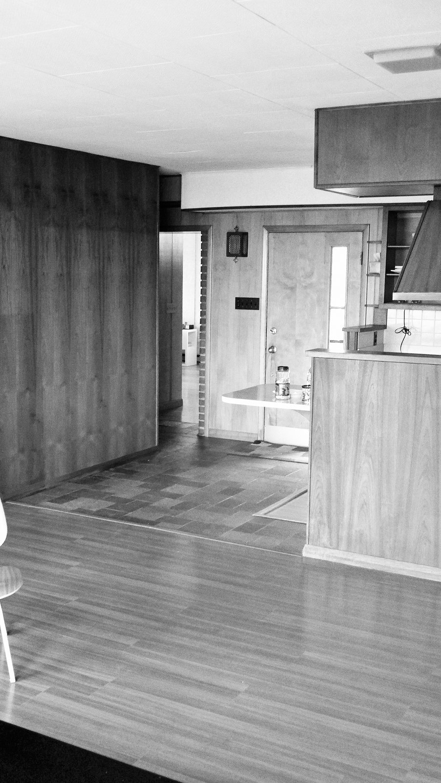The kitchen was formerly closed off and now flows into the living room post renovation.  Photo 4 of 12 in The Midcentury Spirit is Alive and Well in This Hudson Valley Escape