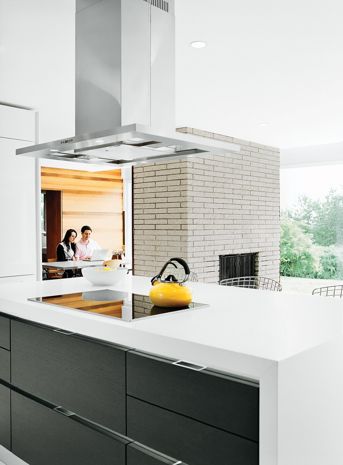Kitchen, Range Hood, and Cooktops The cooktop and oven are Miele, the counter-top is Caesarstone, and the refrigerator is Liebherr.  Photo 6 of 12 in The Midcentury Spirit is Alive and Well in This Hudson Valley Escape