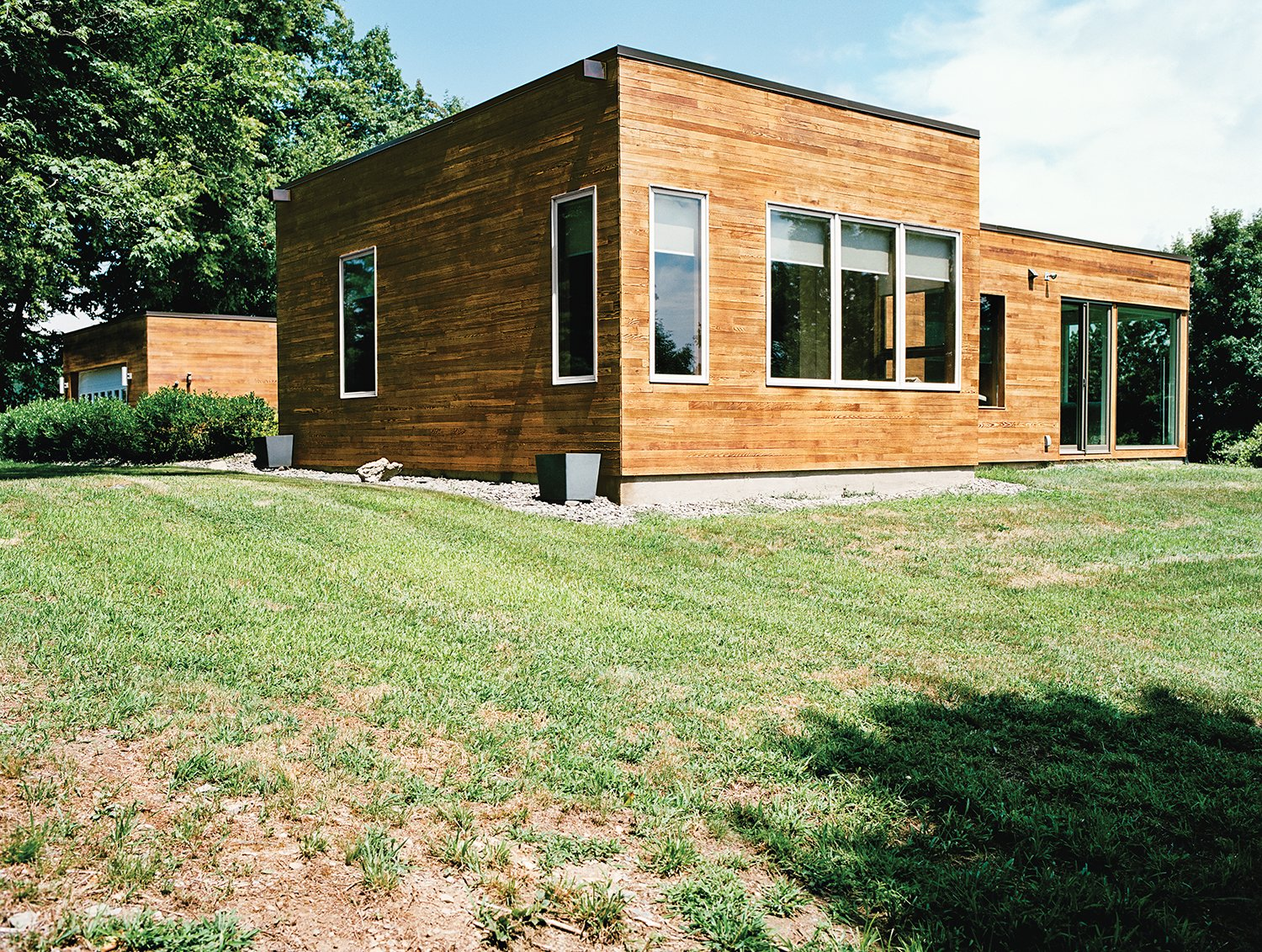 Exterior, Mid-Century Building Type, House Building Type, and Flat RoofLine The previous residents sheathed the exterior in cedar, which the Citrons loved and decided to keep.  Photo 11 of 12 in The Midcentury Spirit is Alive and Well in This Hudson Valley Escape