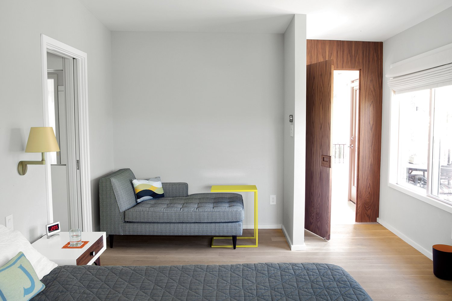 """Bedroom and Bed """"Life happens around architecture. And that's fine: A lot of houses get more beautiful when they age.""""   —Architect Rick Black  Photo 5 of 11 in A Renovated Midcentury Gem in Austin"""