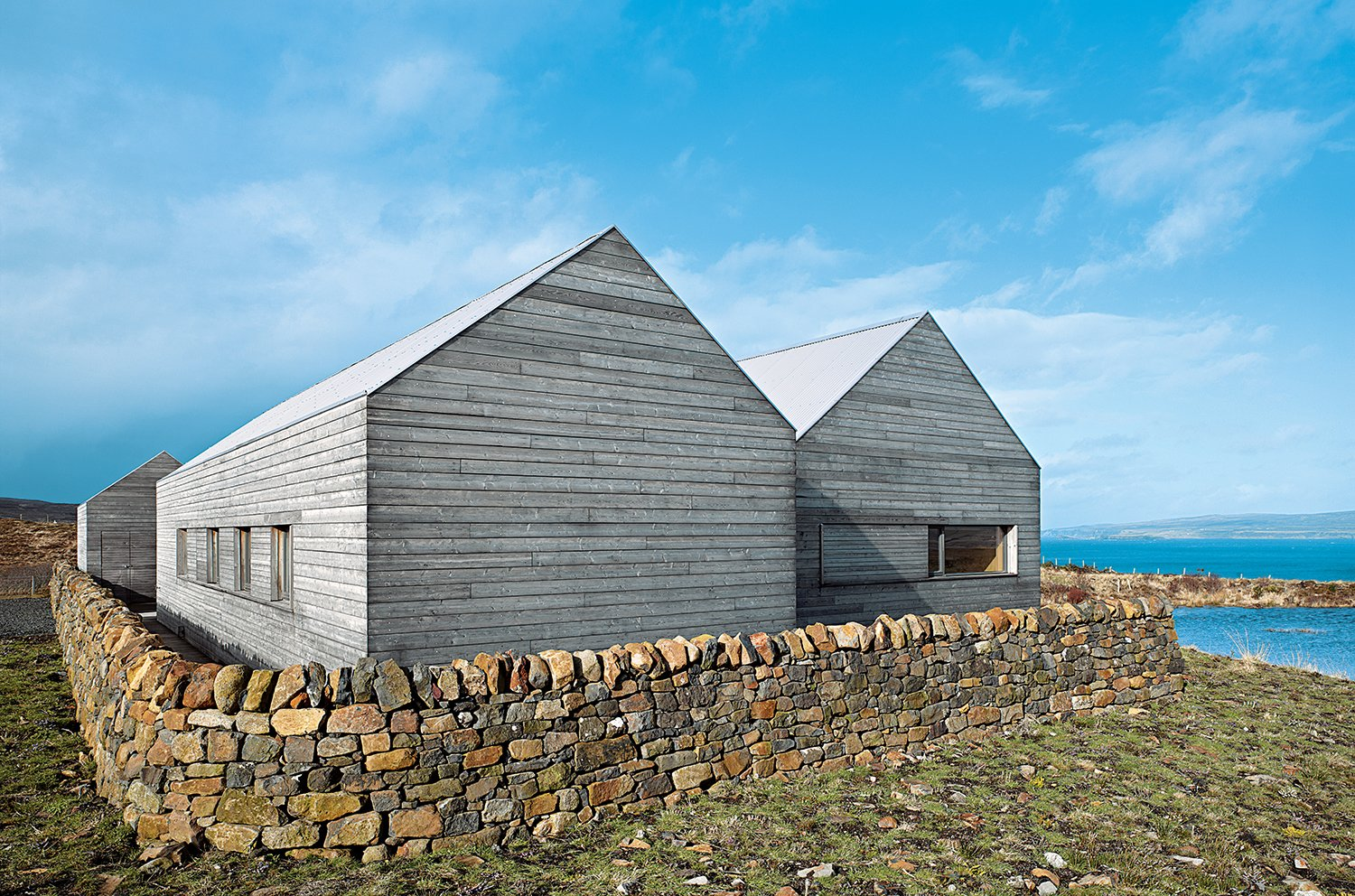 Dominic Houlder's monastic residence features a Caithness stone floor and oak-veneered walls and ceiling.  Photo 3 of 3 in A Pitched-Roof Dwelling on Scotland's Isle of Skye