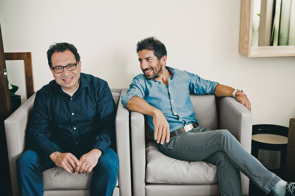 Designer Khodi Feiz (left) and his younger brother, Reza (right), congregate with their families every summer, usually in Europe. This year, Khodi prefaced a California road trip with his brood with a visit to Reza's home and studio in Los Angeles.