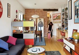 An Eames Storage Unit helps to define distinct living and dining spaces. A Melo sofa from BoConcept faces a chest of drawers that Drew found at a Manhattan flea market.