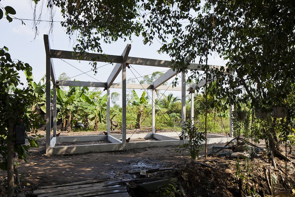 With an average income of $130 a month, residents of the Mekong Delta often create similarly sized thatched housing, but the standard timber frames warp due to flooding and weak soil. The concrete frame costs more upfront, but last much longer.  Photo 4 of 7 in A $4000 Prefab Prototype in Vietnam