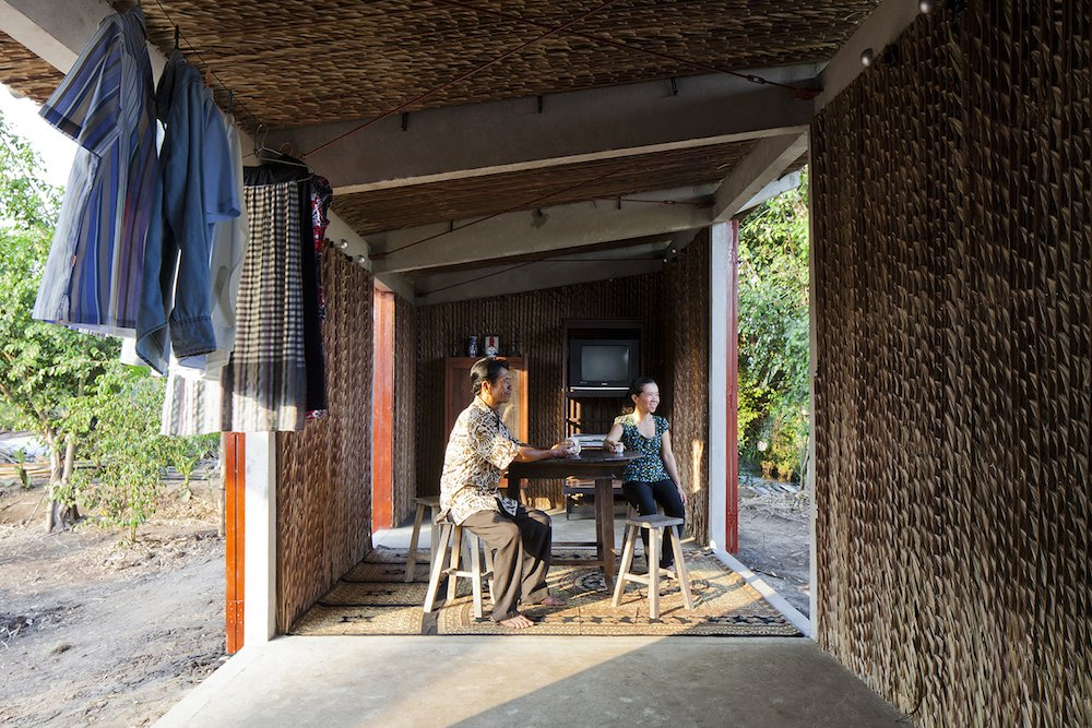 The modest, 322-square-foot interior opens up into the environment.  Photo 5 of 7 in A $4000 Prefab Prototype in Vietnam