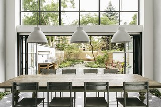 """The original home's dilapidated rear wall was in such poor condition that Roberts called it """"an opportunity in disguise."""" She removed the wall and built a two-story addition that features double-glazed windows and sliding doors for unified entertaining inside and in the garden."""