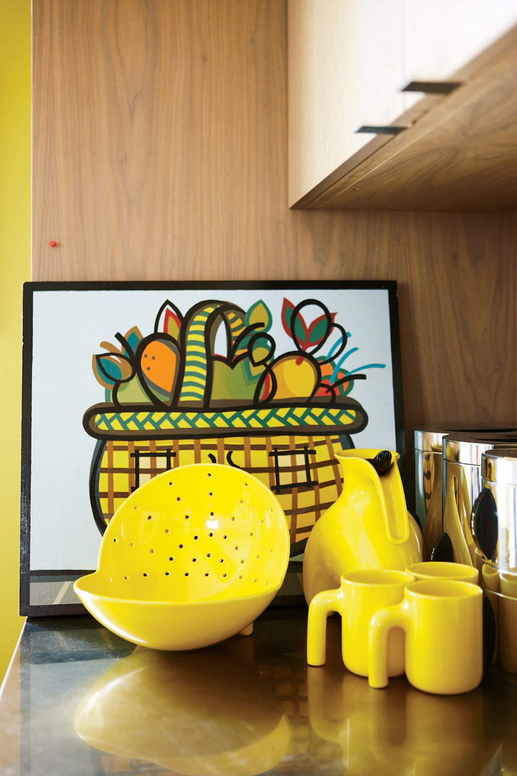 Shopping Mall Fruit Basket, a painting by Peter B. Hastings, shares space with a special-edition Royal Copenhagen tea set and a photograph by Tokyo-based artist Keith Ng. Tagged: Kitchen and Wood Backsplashe.  Photo 3 of 15 in Party-Friendly Apartment in Toronto