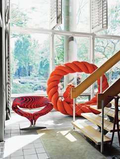 The ground floor of the house opens up to a three-story atrium and hosts a few pieces from Larsen's wide-ranging collections, like a rope sculpture by Mariyo Yagi.