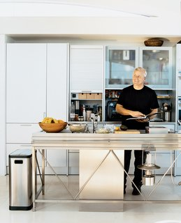 "Opening onto the open-plan living and dining rooms, the aluminum Bulthaup System 20 kitchen with its nine-foot-long stainless steel island and Miele appliances has become a focal point of the house. Pressed in one seamless sheet of steel, the island, Picard says with the obvious pride of a satisfied customer, ""is an amazing piece of engineering."""