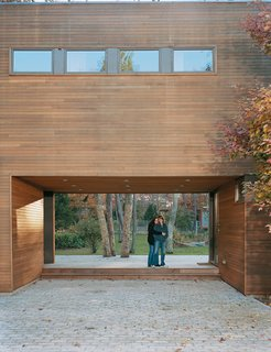 Tanya Wexler and Amy Zimmerman linger in the breezeway designed to draw eyes, and footsteps, from the driveway through the house to the gently sloping backyard and swimming pool beyond.