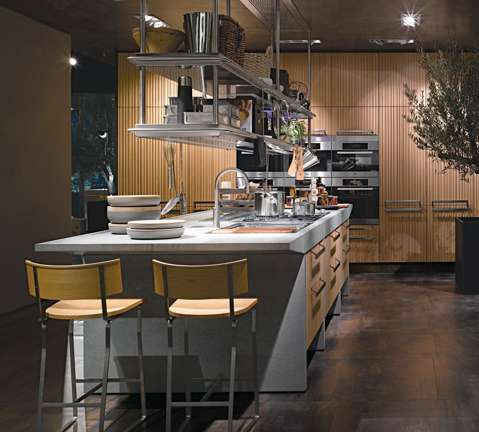 Arclinea's Lignum and Lapis kitchen system features green materials, professional-grade appliances, and advanced technology like a miniature greenhouse for growing herbs indoors and a retractable glass hood over the cooktop.  Photo 5 of 7 in An Introduction to Kitchen Design