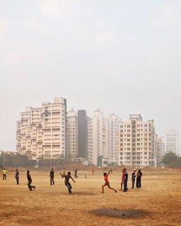 An impromptu cricket game occupies locals in Navi Mumbai.