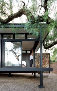 A Mies van der Rohe-Inspired Cottage in Johannesburg - Photo 1 of 1 - Architect Georg van Gass adds a delicately poised cantilevered exterior wall that appears to slice the deck in half. Photo by: Elsa Young