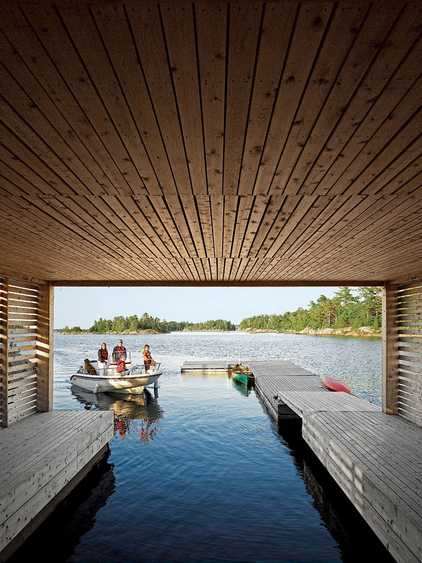 Outdoor, Small Patio, Porch, Deck, and Wood Patio, Porch, Deck The view from inside the Floating House's boat dock.  Photo 14 of 16 in Floating House, Lake Huron