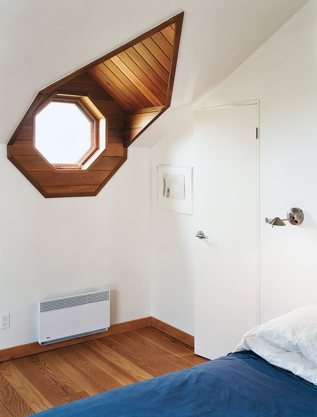 The porthole window in the master bedroom not only evokes the sea, it looks out onto it.