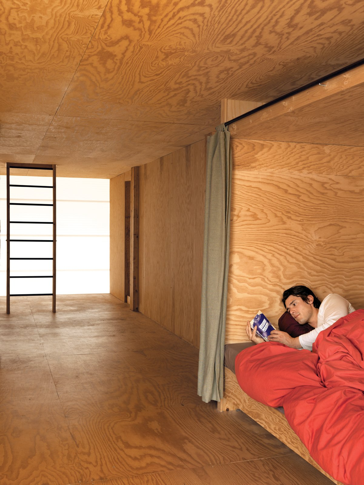 Bedroom and Bed The second floor houses three lits bretons, boxlike compartments where the curtains can be drawn to close sleepers off from the world. Inside, each has a built-in shelf   for personal belongings and a favorite read.  Photo 10 of 11 in Modern Wooden A-Frame Retreat in France