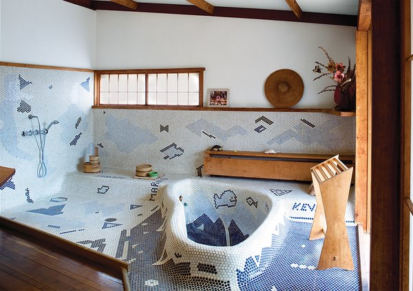 The sunken bathtub in George Nakashima's Sanso Villa mimics the shape of a swimming pool on the grounds. His daughter, Mira Nakashima, took over the studio after his death and now lives and works on the property.