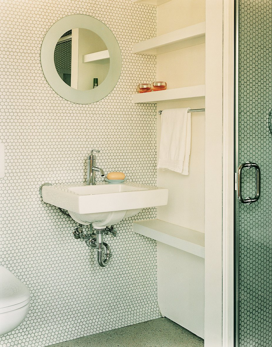 """Bath Room, Wall Mount Sink, and Mosaic Tile Wall In the guest bathroom, penny tiles were chosen """"because they're incredibly economical, utilitarian, and we liked their kitschy feel,"""" explains Gaffney.  Photo 7 of 10 in Gaffney House Dining Room from Leave it to Beavers"""