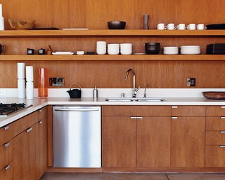 Inspired Indoor Teak Looks - Photo 3 of 14 - The kitchen cabinetry, custom designed by the architects, is smooth brown teak. The faucet is by Hansgrohe, and the dishwasher is by Bosch.