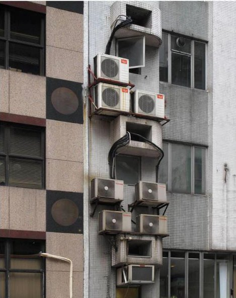 An exterior detail shows a jumble of air-conditioning units. Photo by Michael Wolf, courtesy of the Flowers Gallery.  Photo 3 of 7 in Megacity Living in Hong Kong: Architecture of Density