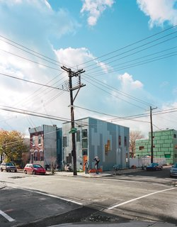 The HardiePanel siding on the adjacent 100K and 120K houses is a dramatic break from East Kensington's mostly brick facades. The simple, well insulated box and the absence of a third floor keep each house affordable, sustainable, and within the reach of young families.