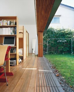 The magic wall-disappearing act is accomplished by means of sliding glass panels, which the family tends to leave open almost year-round. Miharu Higashibata says she feels the new home has strengthened the family bond through shared activities like cooking and gardening.