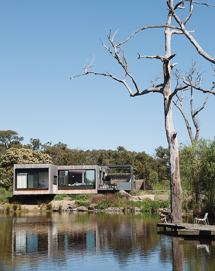Exterior, House Building Type, and Wood Siding Material Perched above a lake on Australia's verdant Mornington Peninsula, James and Imogen Tutton's teak-clad house was designed by Karen Alcock of Melbourne-based MA Architects.  Photo 1 of 8 in Living Simply on a Lush Australian Estate