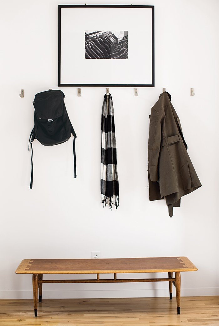 Hallway and Light Hardwood Floor Inside the front door, coats hang from aluminum Bjärnum hooks by Ikea above a vintage Lane coffee table, which Magill bought from a coworker, and beneath a photograph by Beth Mercer.  Photo 3 of 12 in A Versatile House Fulfills All This Musician's Needs