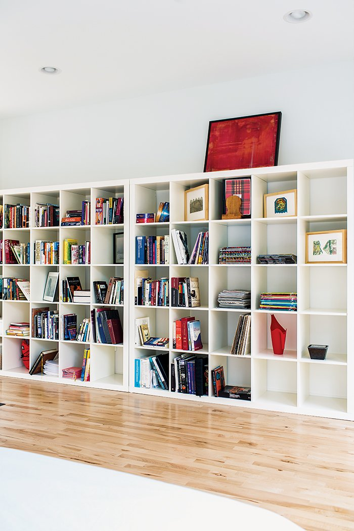 Living Room, Storage, Shelves, Light Hardwood Floor, Recessed Lighting, and Bookcase A pair of Ikea Expedit shelving units line one wall of the sleeping area.  Photo 10 of 12 in A Versatile House Fulfills All This Musician's Needs