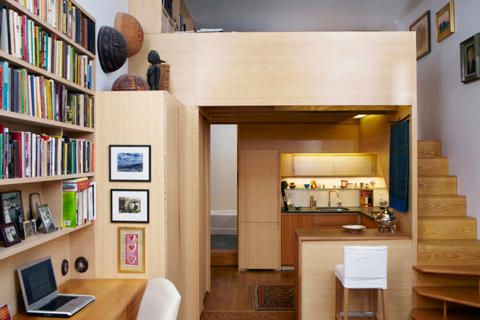Faced with the challenge of a diminutive New York apartment in desperate need of a refresh, architect Tim Seggerman went straight to his toolbox to craft a Nakashima-inspired interior. Photo by David Engelhardt.  Photo 4 of 8 in Space-Saving Wood-Paneled Apartment in Manhattan