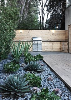 A water-saving project in Menlo Park includes a rock bed with succulents.