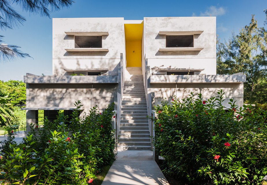 Architect John Hix—who, as one might gather, worked under renowned American architect and concrete aficionado Louis Kahn—designed the hotel Hix Island House in Vieques, off Puerto Rico. The latest guest house on the property is called Casa Solaris and is entirely removed from the commercial grid, running completely on solar power. Photo by Michael Grimm. Tagged: Exterior, House, Concrete Siding Material, and Flat RoofLine.  Photo 1 of 10 in Find Yourself in Paradise at These 10 Modern Rentals in the Caribbean from Modern Concrete Getaway in Paradise